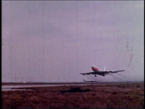 1962 TS large passenger airliner taking off / New York, New York, United States
