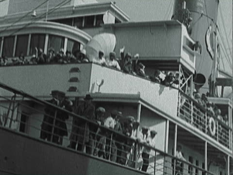 MONTAGE Large passenger liner pulling into port and crowds waving / New York, New York, United States