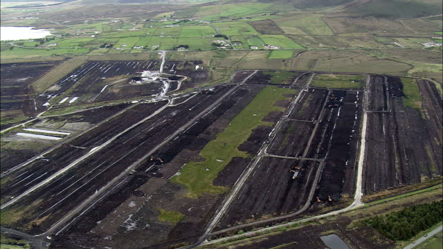 large peat works  - aerial view - connaught, county mayo, ireland - restoring stock videos & royalty-free footage