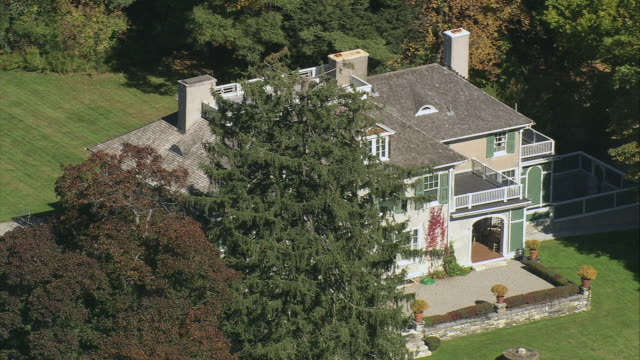 aerial large period style two story mansion, chesterwood estate, set among heavily wooded area / stockbridge, massachusetts, united states - stately home stock videos and b-roll footage