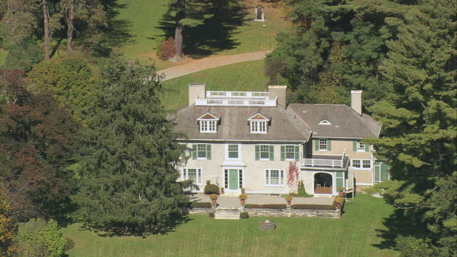 AERIAL Large period style two story mansion, Chesterwood Estate, set among heavily wooded area / Stockbridge, Massachusetts, United States