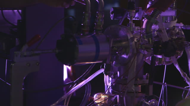 "a large piece of complex machinery is rotated in a lab - ""bbc universal"" stock-videos und b-roll-filmmaterial"
