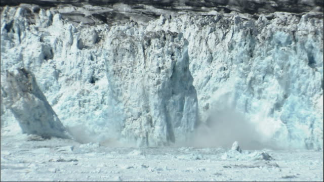 Large pieces of the Columbia Glacier break off and crash into the ocean. Available in HD.