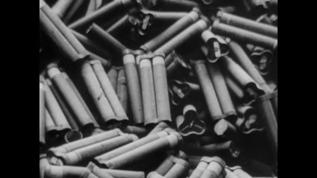 large pile of empty artillery shells piled high far on iwo jima beach other debris along beach mount suribachi bg - schlacht um iwojima stock-videos und b-roll-filmmaterial