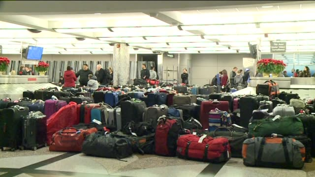 kdvr large piles of unclaimed luggage due at denver international airport due to flight delate on december 29 2015 delays at the airport plagued many... - hand luggage stock videos & royalty-free footage