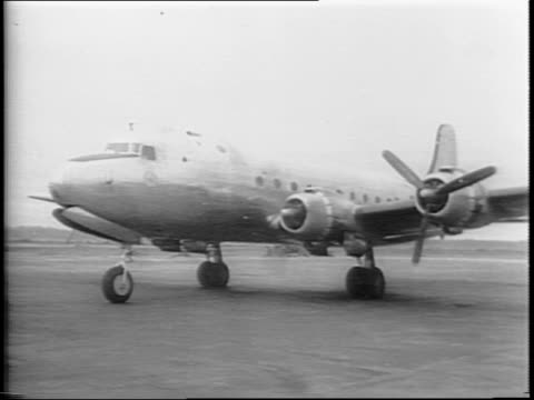 a large plane lands on a runway / prime minster clement attlee and entourage walk on the runway toward secretary of state james byrnes / attlee and... - air vehicle stock videos & royalty-free footage