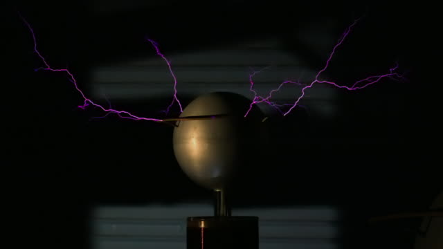 large plasma ball emitting purple sparks - electric lamp stock videos & royalty-free footage