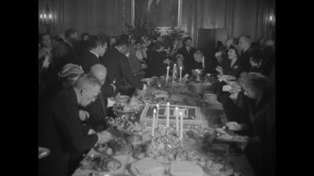 large portrait of joseph stalin / people at buffet table / cake with xxxiii being cut / roasted fowl - north america stock videos & royalty-free footage