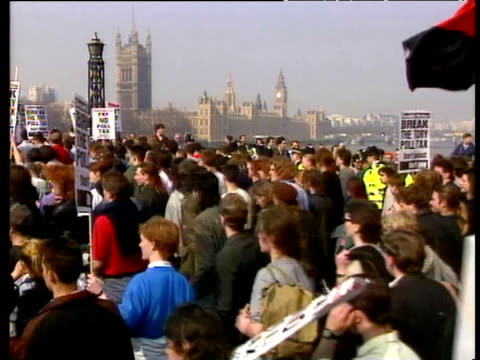 large protest march against poll tax crosses lambeth bridge approaching westminster demonstration later becomes violent resulting in rioting 31 mar 90 - marching stock videos and b-roll footage