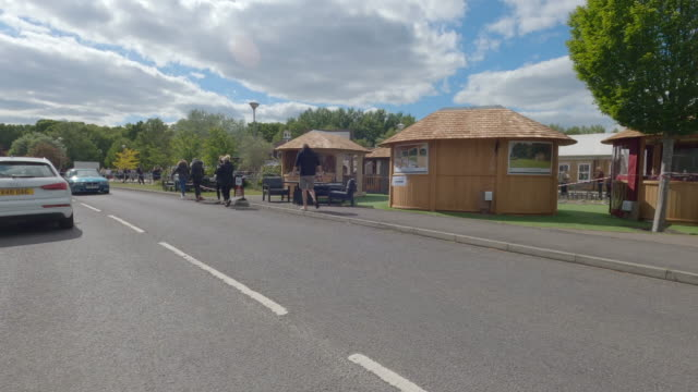 large queues gather outside surrey garden centre on the day they reopen after 7 weeks of closure on may 13 in surrey england this is the day england... - car point of view stock videos & royalty-free footage