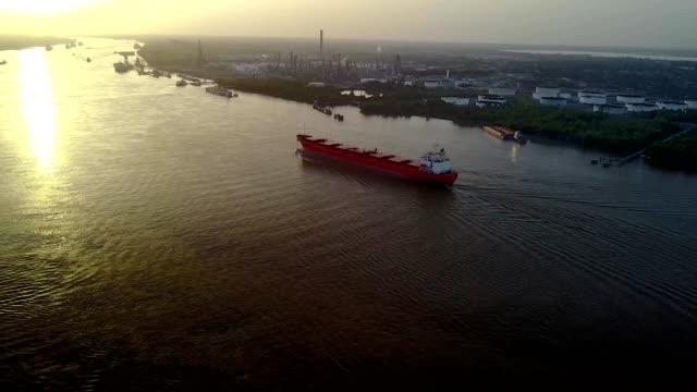 A Large red shipping port travels up the Mississippi River in New Orleans Louisiana
