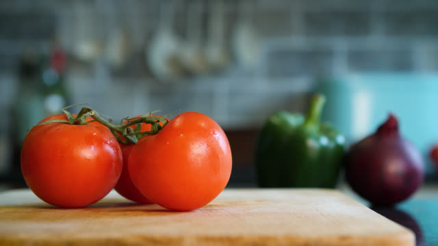 a large red tomato is cut in half and into slices - tomato stock videos & royalty-free footage