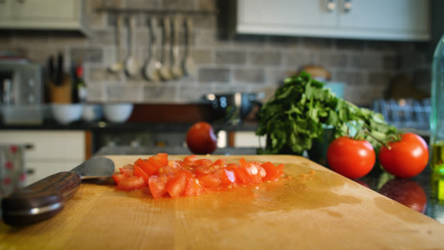 large red tomato is diced by kitchen knife - chopping board stock videos & royalty-free footage