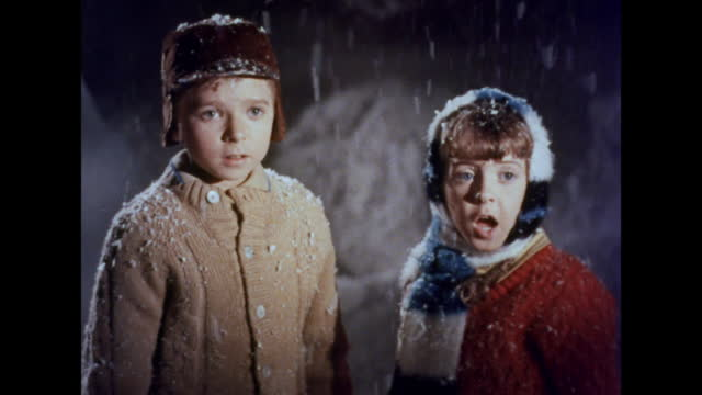 stockvideo's en b-roll-footage met 1964 a large robot captures two children - archief