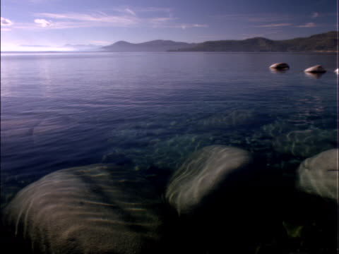 large rocks along lakeshore - washtub stock videos and b-roll footage