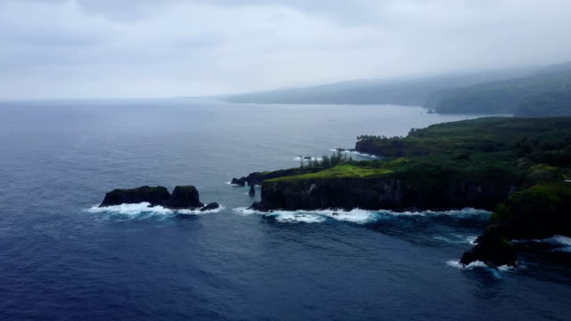large rocky outcrop on maui island by drone - peninsula stock videos and b-roll footage