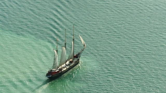 large sailboat crossing lake ontario. medium shot from above - spoonfilm stock-videos und b-roll-filmmaterial