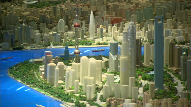 vídeos de stock, filmes e b-roll de cu large scale model of city of shanghai in year 2020 on display at shanghai urban planning museum, shanghai, china - architectural model