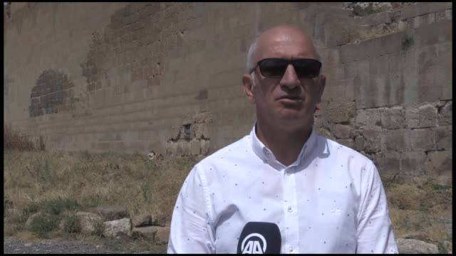a large section of a wall has been excavated at the archaeological site ani also known world city and cradle of civilization in northeast... - kars stock videos & royalty-free footage