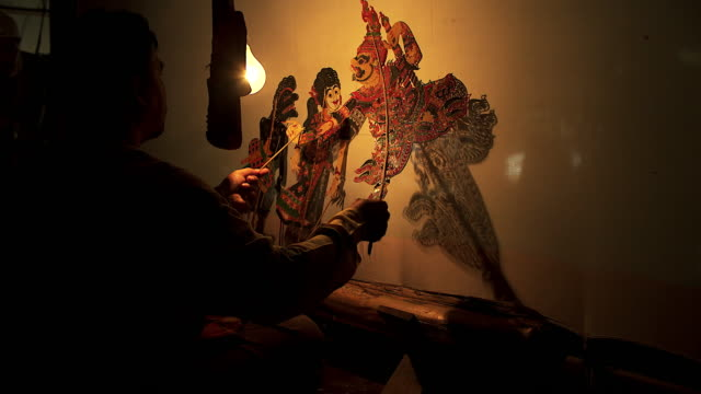 large shadow play or nang yai is a performing. - puppet stock videos & royalty-free footage