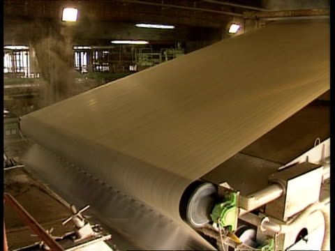 wa large sheet of paper moving on rollers at paper mill - paper mill stock videos and b-roll footage