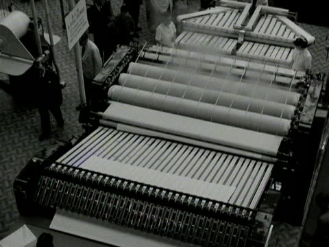 a large sheet pressing machine is demonstrated at a laundry exhibition at olympia - bedclothes stock videos & royalty-free footage
