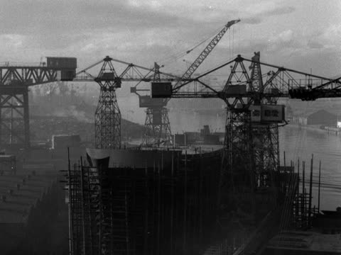 large ship nearing completion is surrounded by scaffolding and cranes at a belfast shipyard; 1953. - shipyard stock videos & royalty-free footage