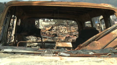 large ship rests amoung burnt out area of kessenuma city after huge fire during tsunami.  filmed on 1 april 2011, 3 weeks after tsunami which was caused by magnitude 9 tohoku earthquake off north east japan / audio - wrack stock-videos und b-roll-filmmaterial