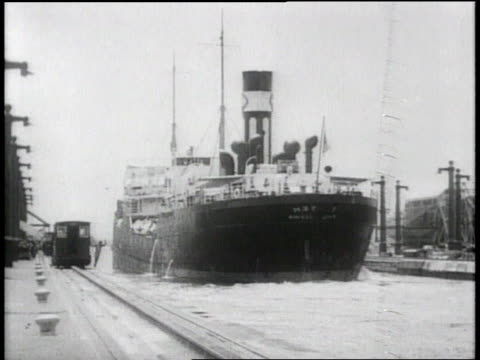 montage large ship sailing in panama canal / republic of panama - 1913 stock-videos und b-roll-filmmaterial