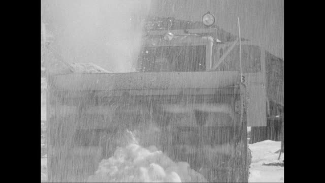 vidéos et rushes de ms large snow plow clearing snow / united states - 1956