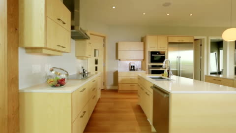 large spaciuos contemporary home kitchen - cabinet stock videos & royalty-free footage