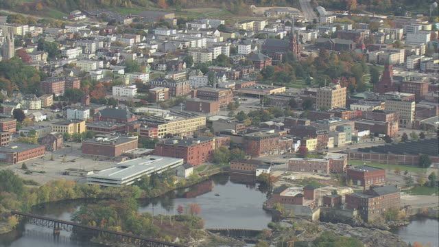 aerial large sprawling town along banks of kennebec river / augusta, maine, united states - augusta maine stock videos & royalty-free footage