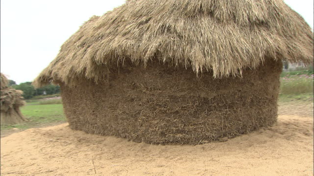 a large stack of hay comprises a japanese funano. - hay stack stock videos & royalty-free footage