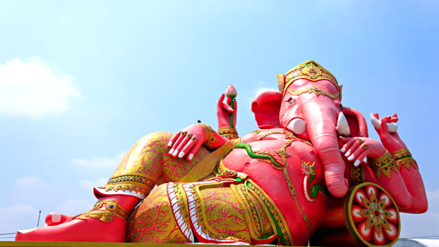 large statue of ganesh.moving cloud timelapse. - god stock videos & royalty-free footage
