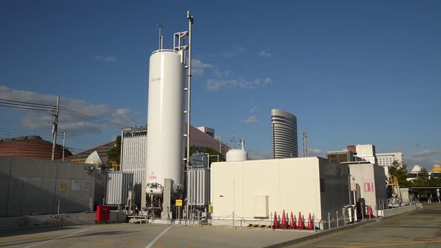 large storage tank at new hydrogen facilities on port island in kobe, japan on monday, october 26, 2020. - nuovo video stock e b–roll