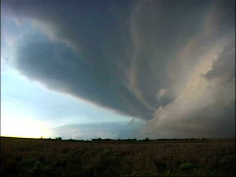 wa large storm cloud patterns over scrub land at dusk, usa - shrubland stock videos & royalty-free footage