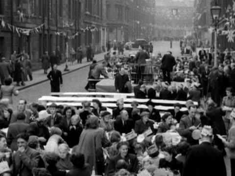 a large street party to celebrate the coronation of elizabeth the second 1953 - 1953 stock videos & royalty-free footage