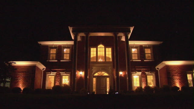 ws zi large suburban home at night with illuminated interior/ temple, texas - temple building stock videos & royalty-free footage