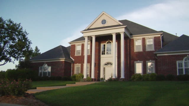 ms large suburban home with columns/ temple, texas - brick house stock videos & royalty-free footage