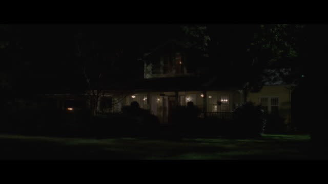 ms, large suburban house with porch at night, usa - veranda stock videos & royalty-free footage
