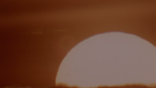 Large sunrise in orange sky / Orange filter