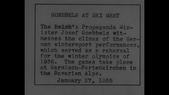 vídeos de stock, filmes e b-roll de large swastika and snowdusted garland with pan to third reich propaganda minister joseph goebbels and other dignitaries in winter attire / he confers... - garmisch partenkirchen