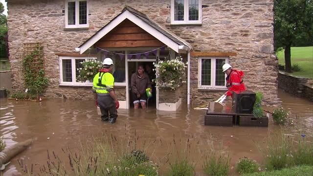 large swathes of the country are affected by flooding this evening, with rivers bursting their banks and bringing misery for homeowners and drivers.... - devon stock videos & royalty-free footage