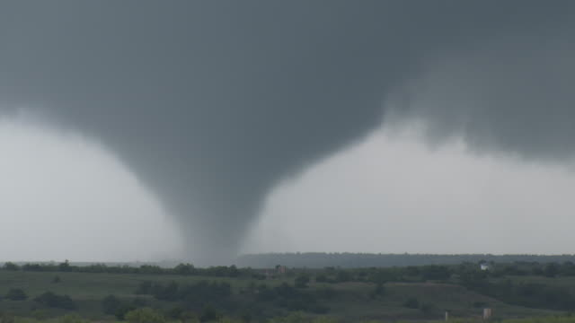 large tornado on the ground over rural oklahoma - oklahoma stock-videos und b-roll-filmmaterial