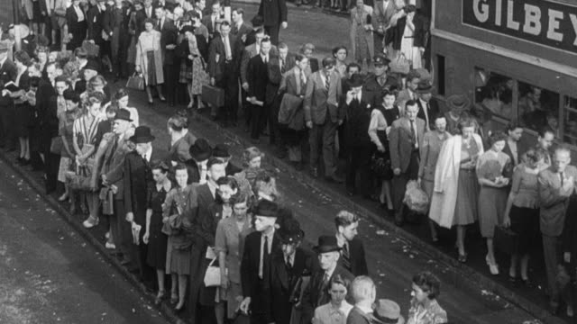 1951 montage large towns introducing the queue for shelter, entertainment, shops, and transportation / united kingdom - fare la fila video stock e b–roll
