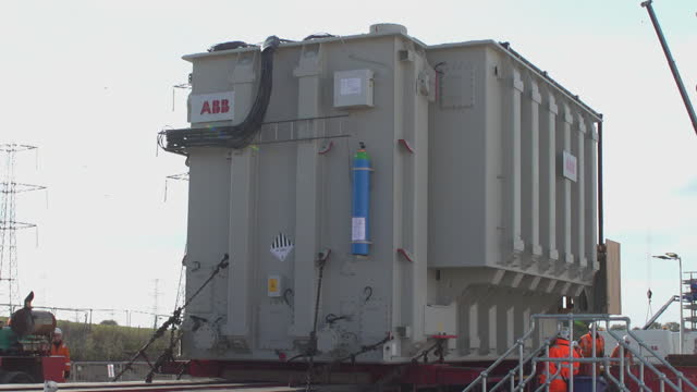 large transformer being installed at electricity substation - installing stock videos & royalty-free footage