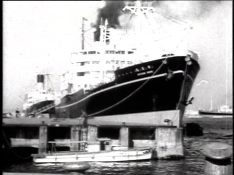 large transport ships in harbor / cargo being unloaded from ship - 1944 stock videos and b-roll footage