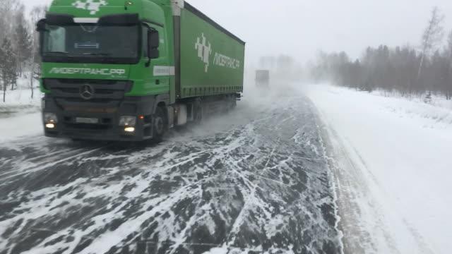 Large trucks carry goods