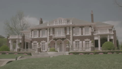 ws large, upscale, two-story brick home with columns and balconies / united states - architectural column stock videos & royalty-free footage