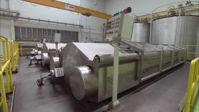 large vats fill a chocolate factory. - bottich stock-videos und b-roll-filmmaterial